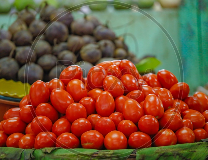 Fresh Tomatoes  In  a Vegetable Vendor Stall or Shop in Market