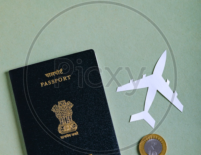 Travel Concept  Indian Passport And Paper Airplane and Indian Coin