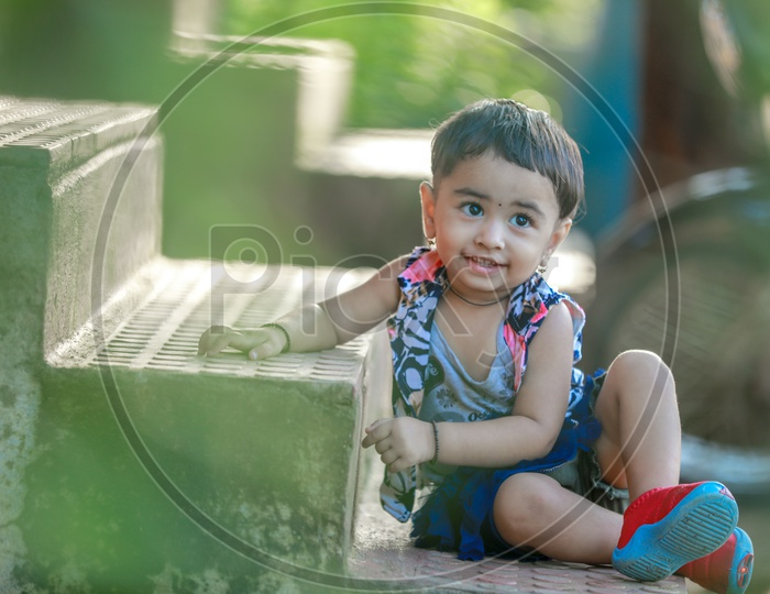 Cute Indian Girl Child Or Baby Girl Playing in a Park