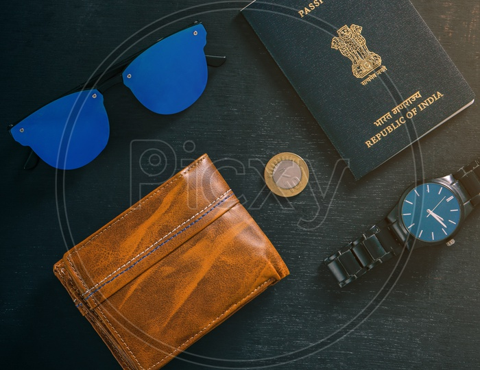 Travel Concept  Indian Passport , Watch ,wallet , Sun Glasses and Indian Coin