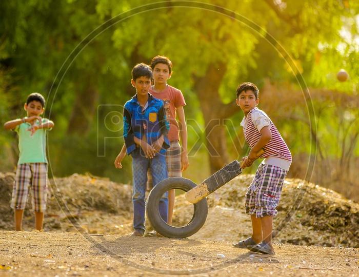 Indian Rural Village Kids Playing Cricket Outdoor