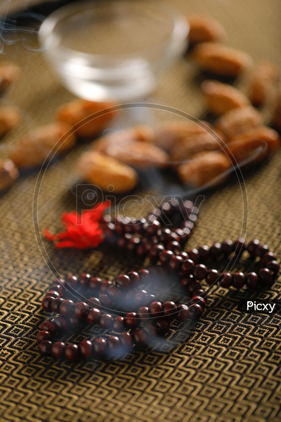 Dry Date Fruits  With Islamic Prayer beads on an Artistic Background   Backgrounds For Ramzan or Ramadan