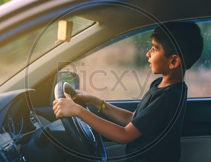Young Indian Boy  or Kid Or Child in Car and Posing
