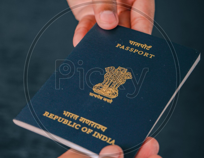 Indian Passport In Hands Closeup  , Showing Passport