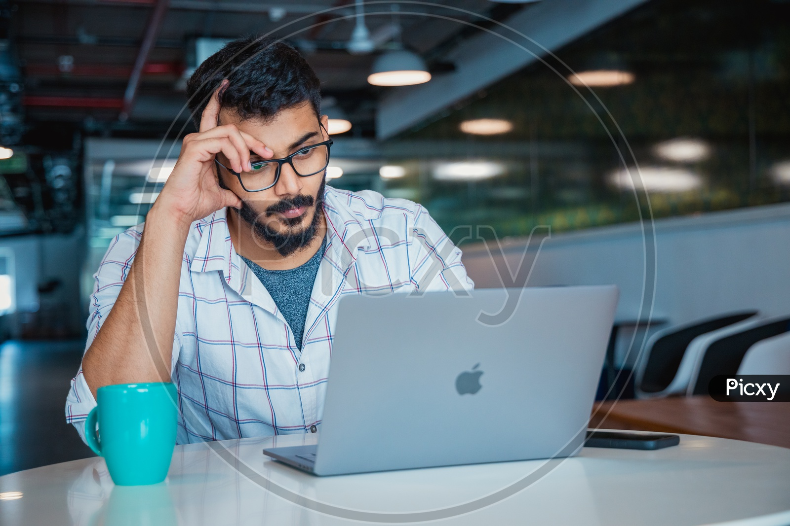 Frustrated Stressed Depressed Thinking Young Man Holding Head in Hands Working on Laptop  in Office Work Space