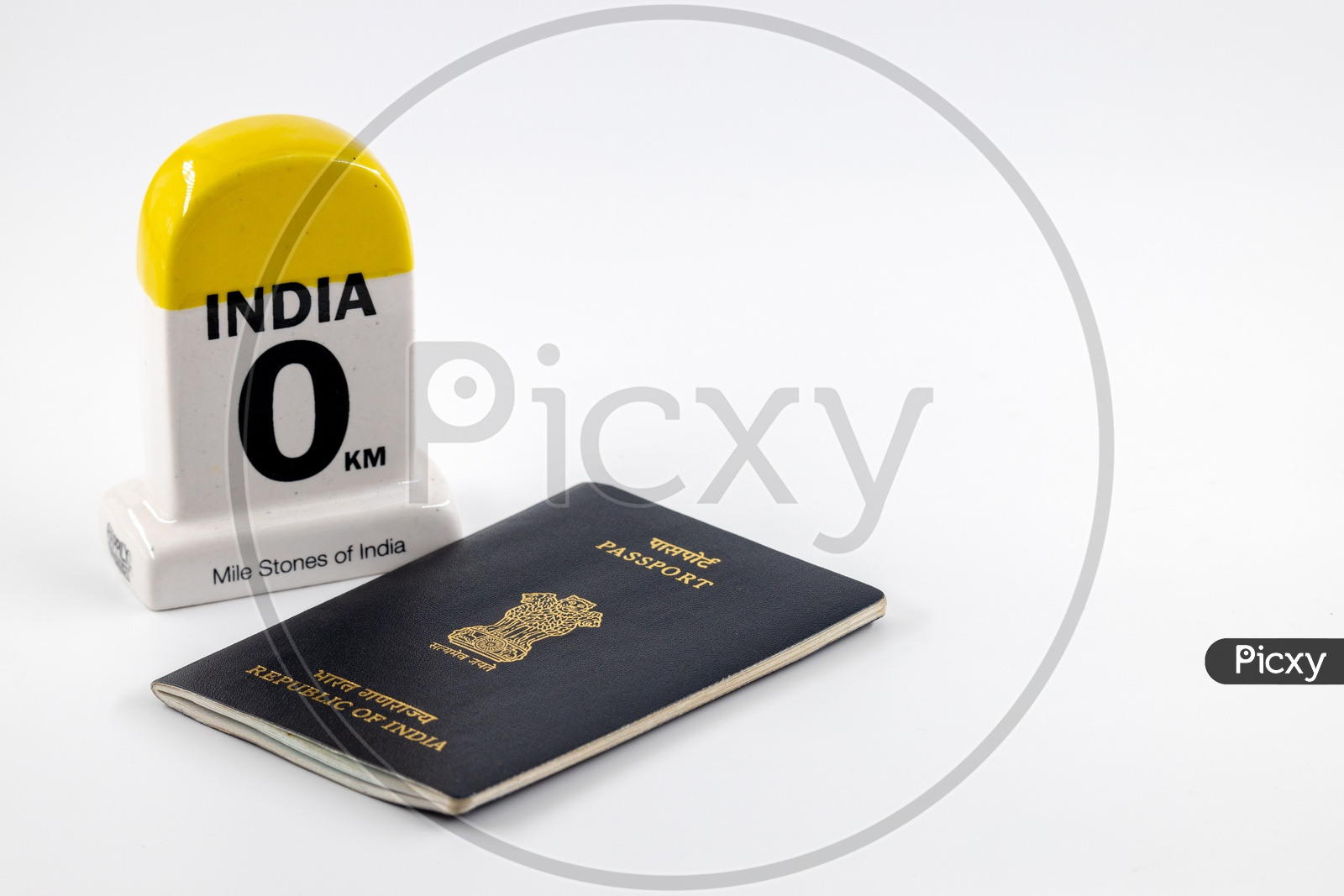 Travel Concept  , Indian Passport With India Mile Stone  on an Isolated White Background