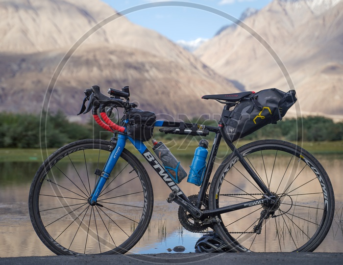 Bicycle Cycle Bike  B-Twin  On  The Roads Of Leh With a View Of Mountains in Background
