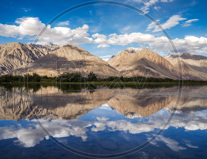 Reflection Of Mountains and Blue Sky On the River Water Surface