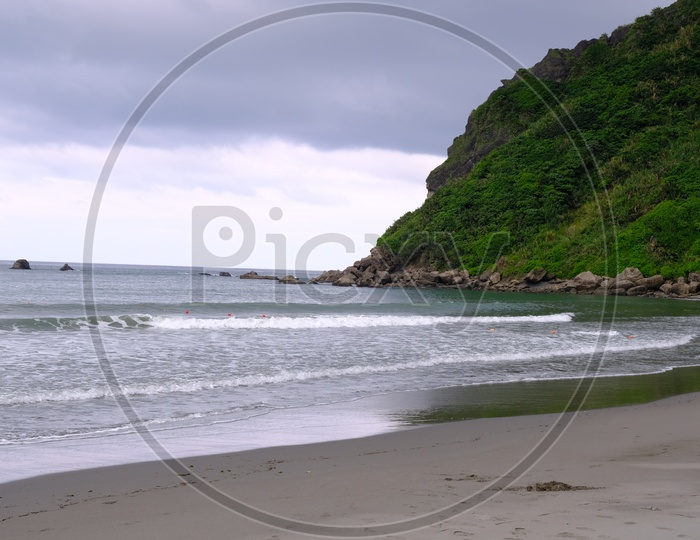 View of Dulan Beach with Greenery Mountains
