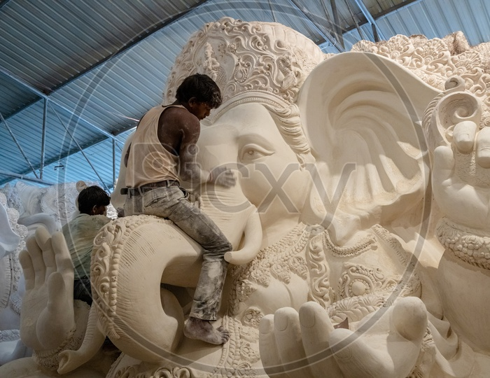 Ganesh Idol Making In Dhoolpet For Ganesh Festival By Artists Giving  Final Finishing   In Workshops