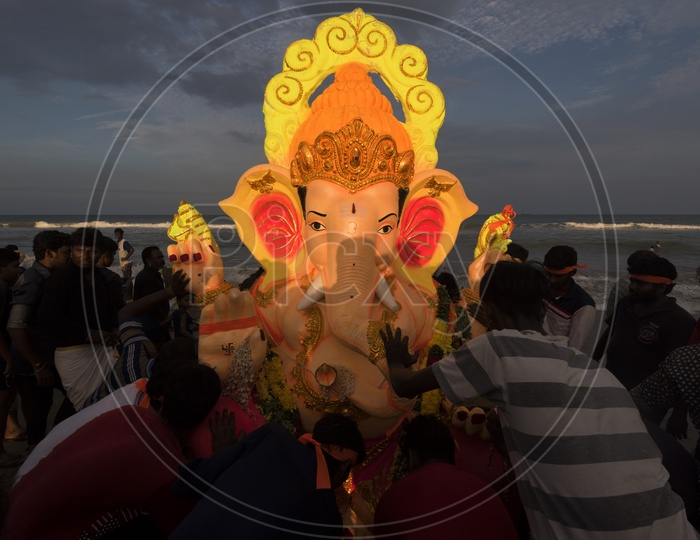 Devotees carrying the Ganesh idol to the sea for immersion.