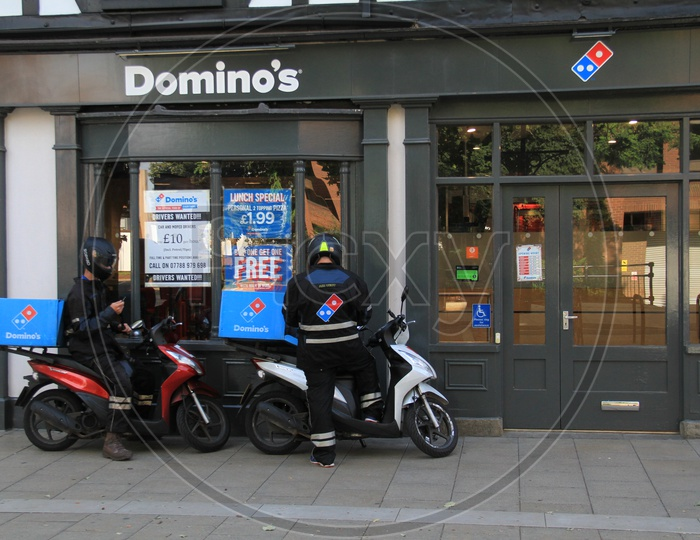 Domino's Delivery Boys with Bikes outside a Outlet