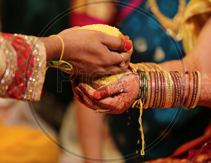 Talambralu in the hands of Bride and Groom
