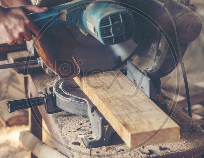 Close up of a Carpenter's work table with different tools and wood cutting stand, vintage filter image