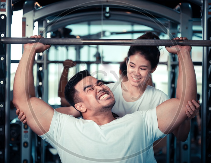 Young Asian Couple Exercising  In a Gym For Fitness