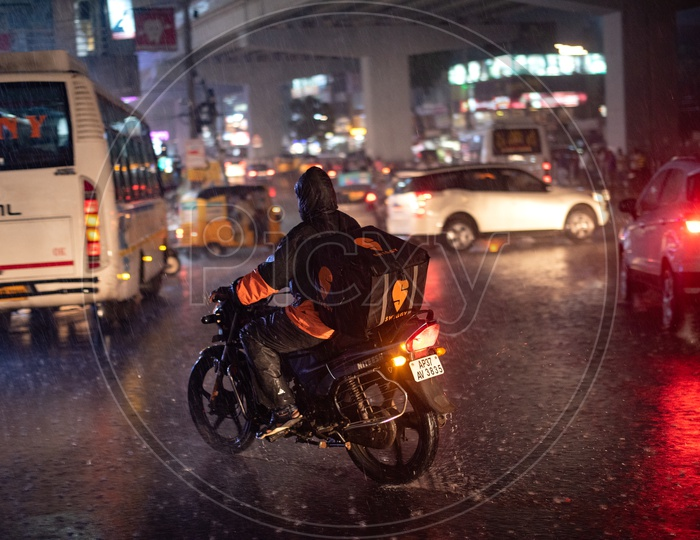 Swiggy Delivery  Agent Delivering Food In Heavy Rain