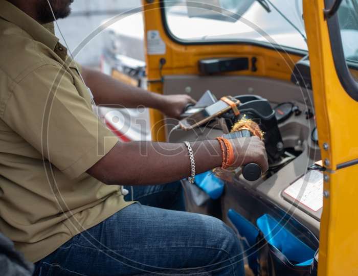 Ola Auto Driver Riding Auto By Putting On Earphones
