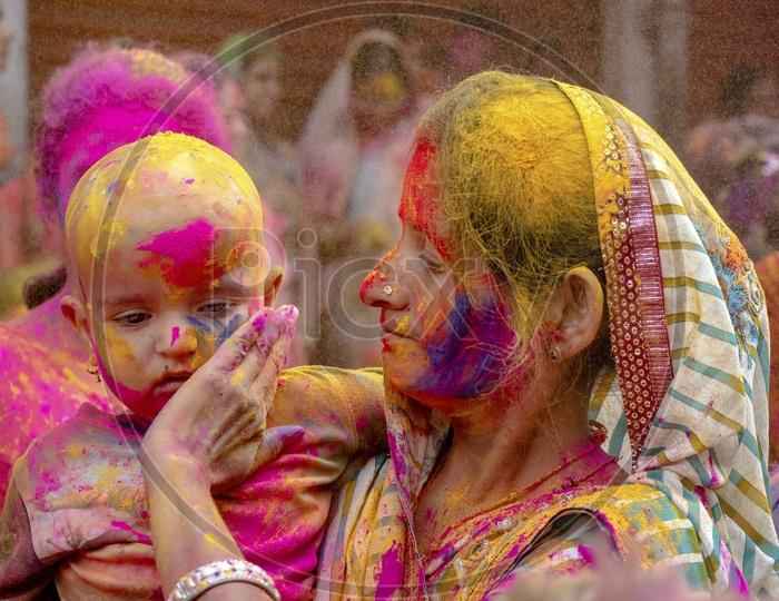 Indian Mother Celebrating Holi With Child