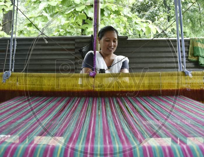A Woman Weaver Weaving Handloom Sarees