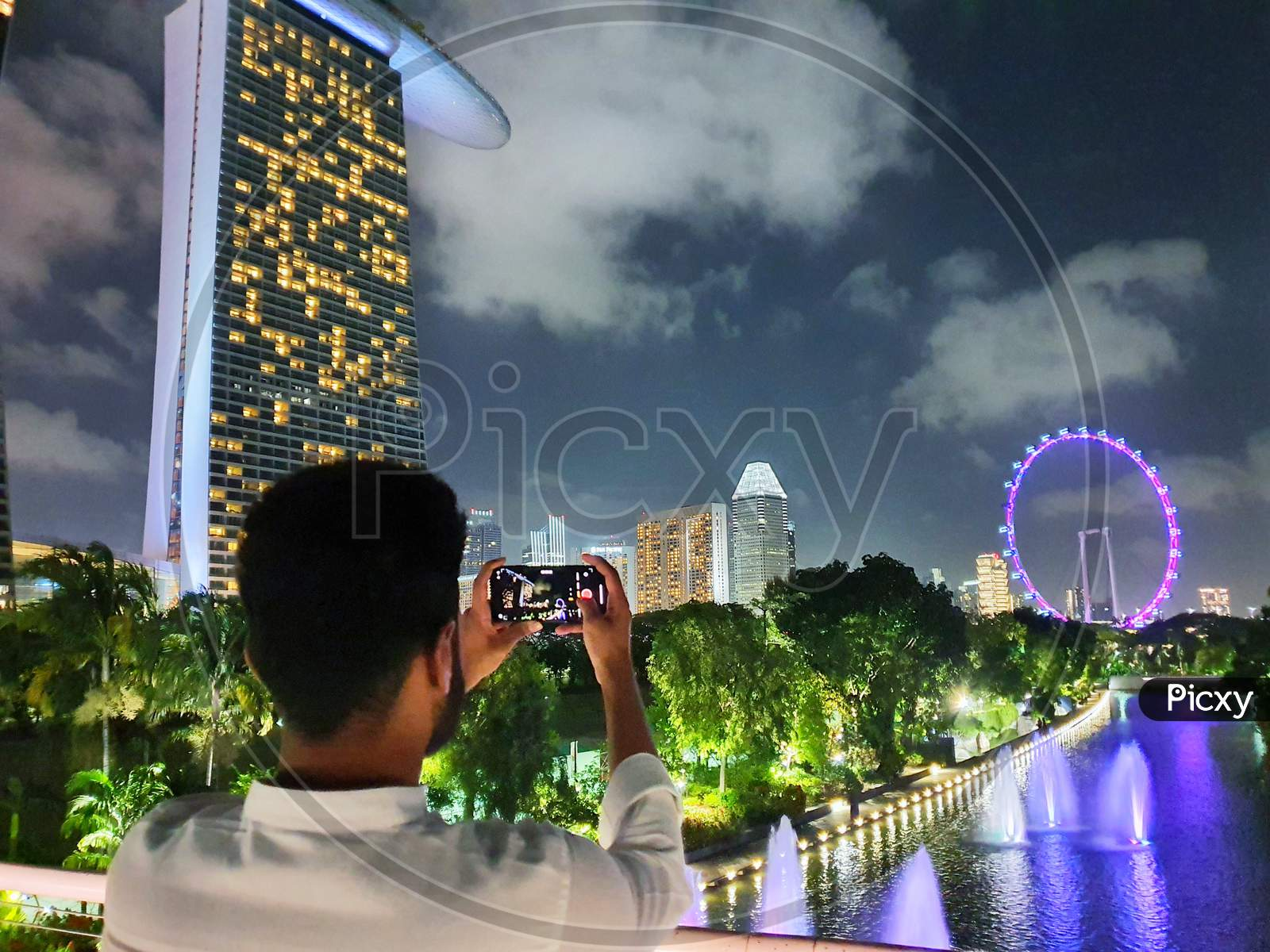 Photographer Clicking At Marina Bay