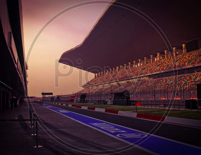 Buddh International Circuit pit-lane and grandstand at dawn, Greater Noida, India