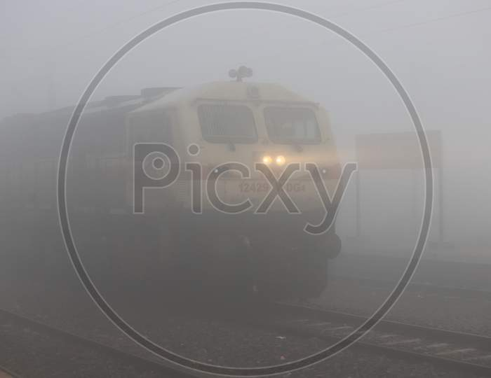 Indian Railways train running On Track in an Winter Morning