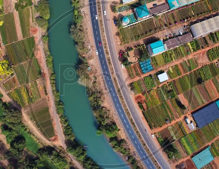 Aerial Shot of Kadiyam Flower & Tree Plantation with Godavari & National Highway