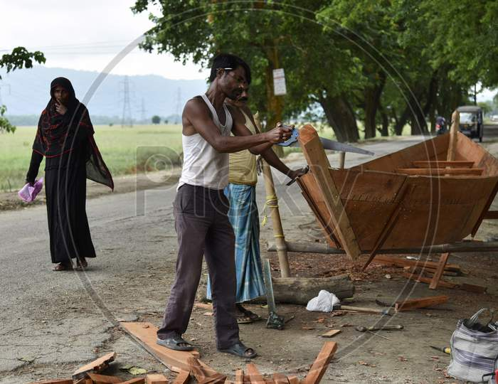 A Indian Man Making A Country-Made At Flood Affected Mayong Village In Morigaon District Of Assam