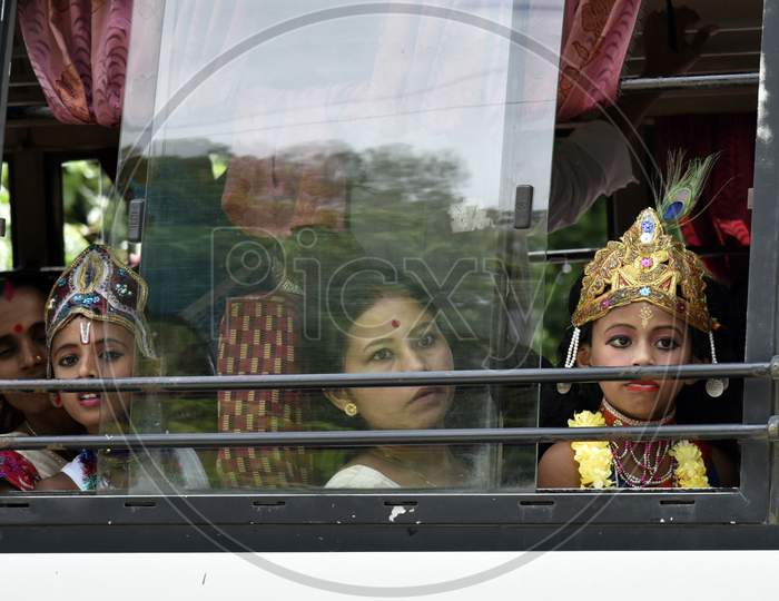 Little Children Dressed Up As Lord Krishna In A Bus During The Janmashtami Festival In Morigaon, Assam, India