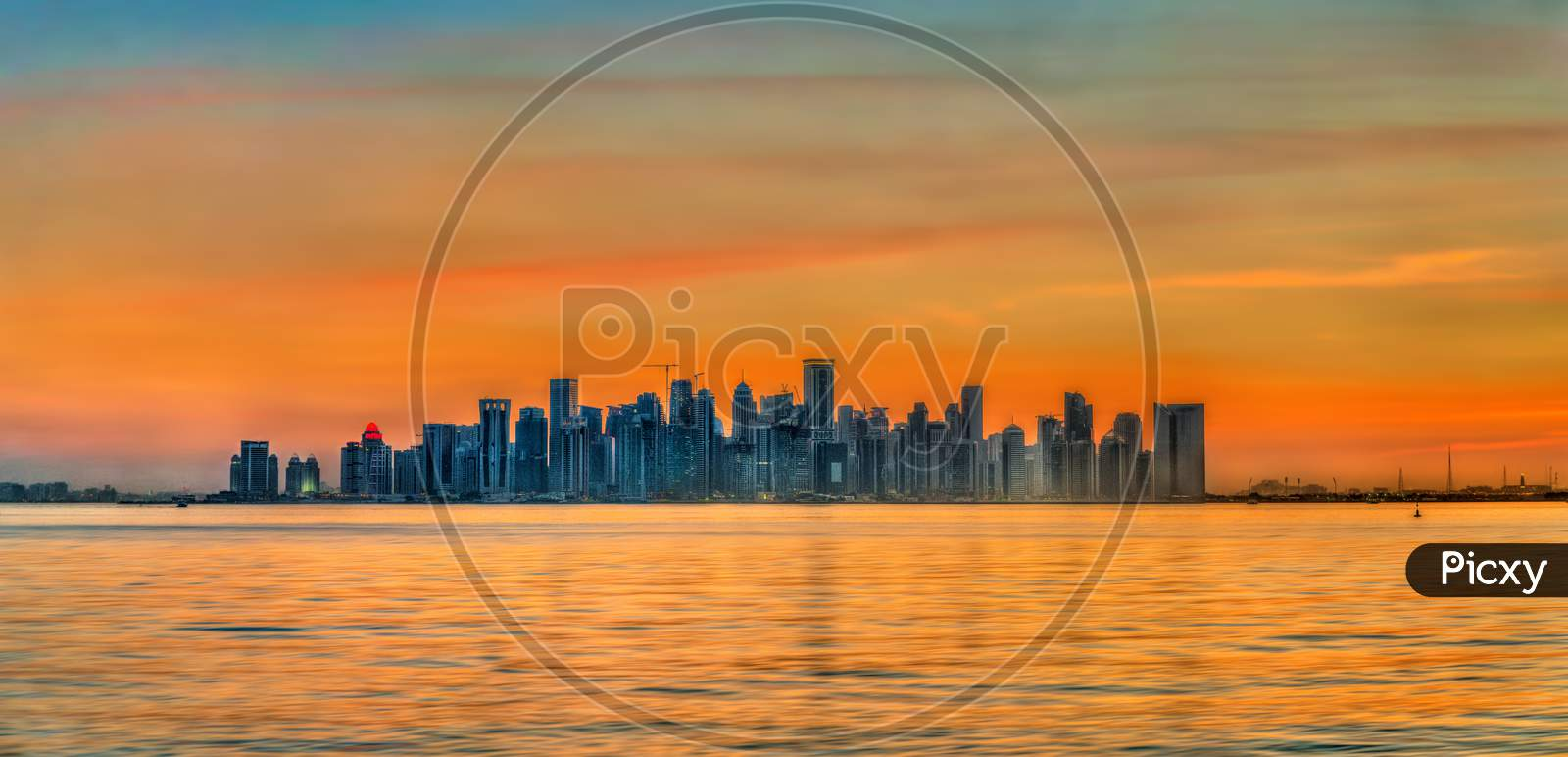 Skyline Of Doha At Sunset. The Capital Of Qatar