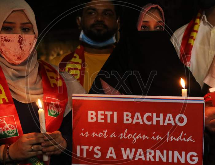 Women hold placards during a protest after the death of a rape victim, on a street in Mumbai, India, September 30, 2020.