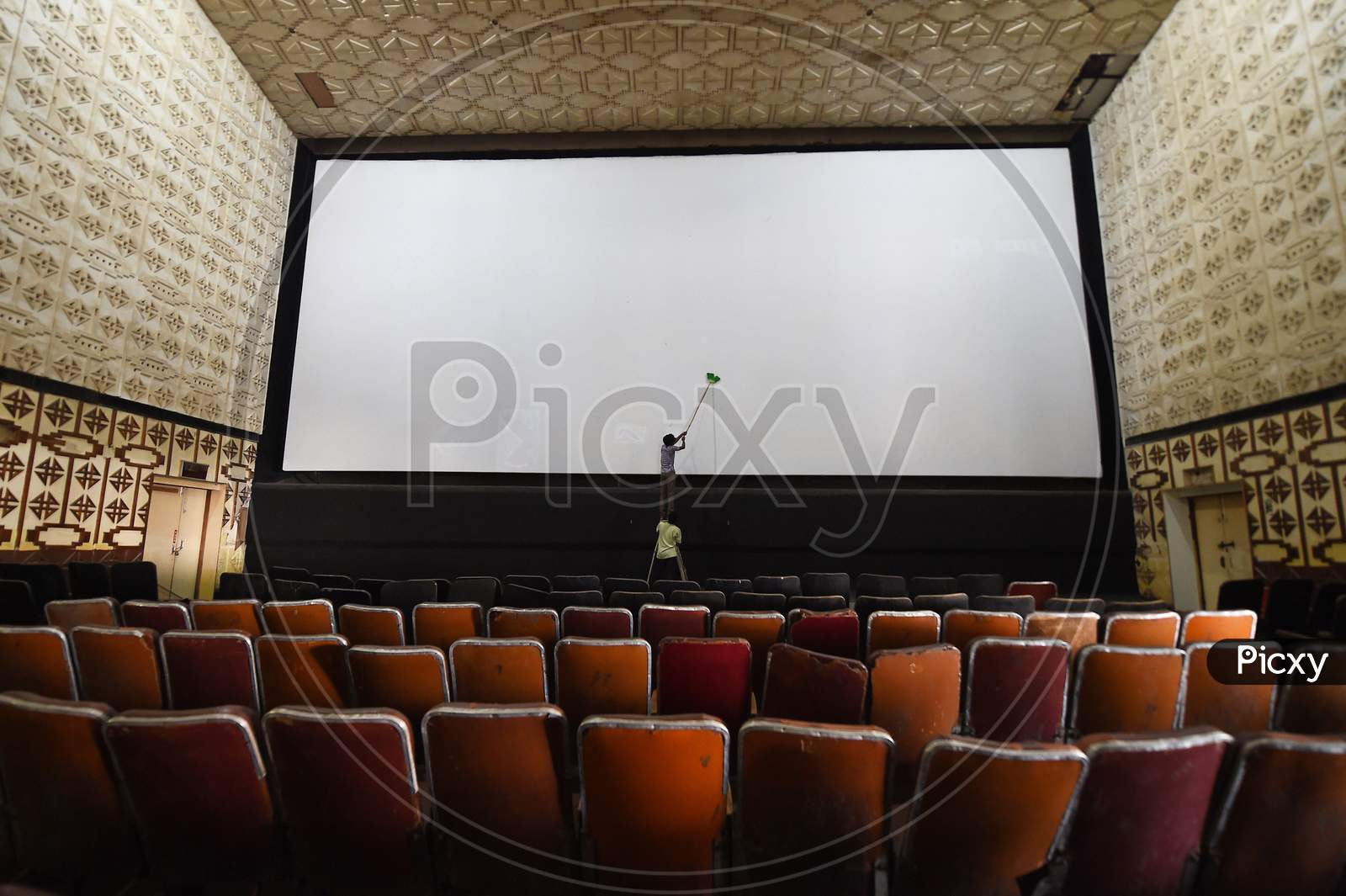 A Worker Cleans A Cinema Hall Ahead Of Its Reopening, During Unlock 5, Amid The Coronavirus Pandemic, In Chennai, Fridayday, Oct.9, 2020