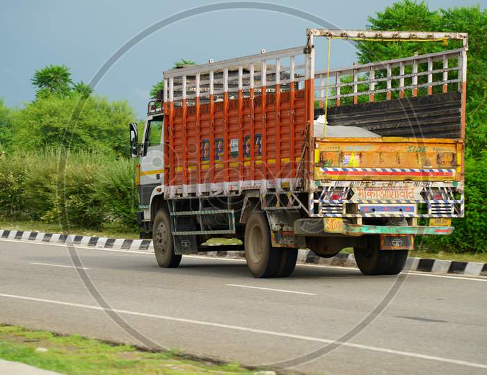 Truck on highway road with red container, transportation concept.,import,export logistic industrial Transporting Land transport on the asphalt expressway