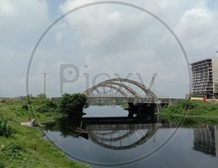 Stylish Steel And Concrete Bridge On Lake