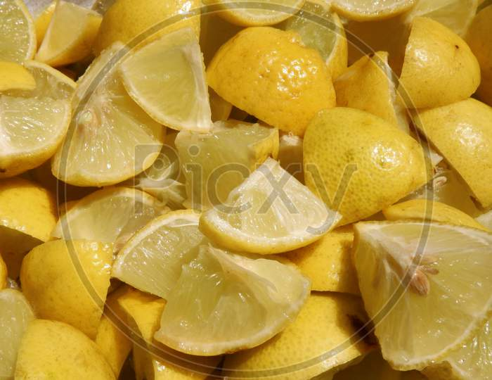Top View Of Fresh Lemon Cut Pieces Group In Background