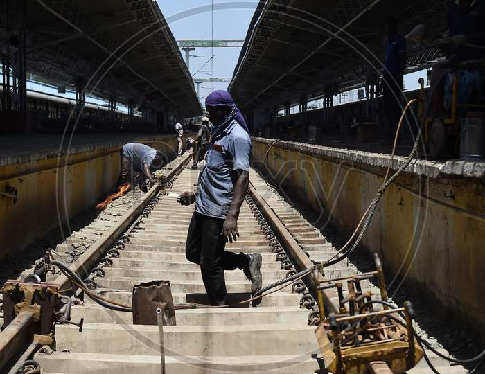 Workers Repair Metal Tracks At A Platform At Central Railway Station As Part Of The Preparations To Reopen The Station Under The Government'S Decision To Ease The Lockdown Put As A Preventive Measure Against The Covid-19 Coronavirus, In Chennai On Friday.Oct.9.2020,