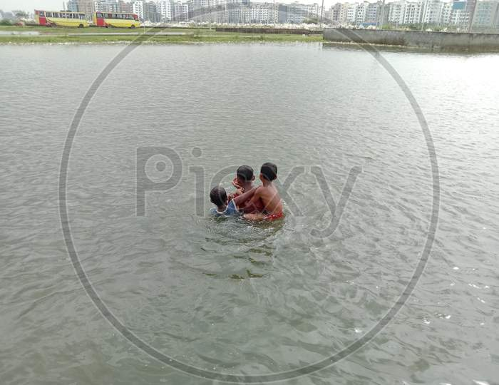 Childs Or Baby Swimming On Lake