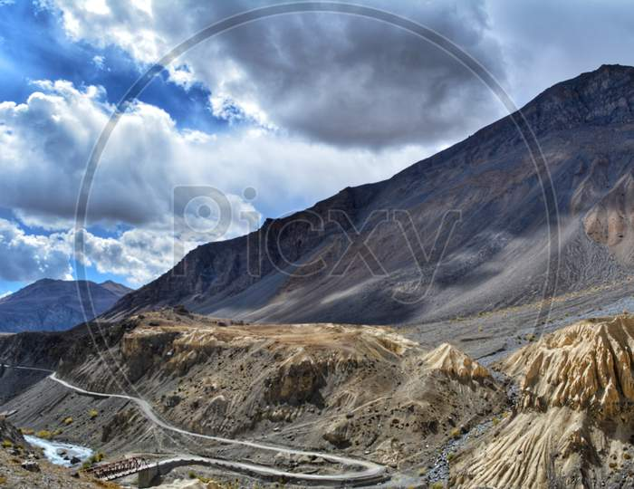 A bridge and a mountain road in Spiti Valley, Himachal Pradesh
