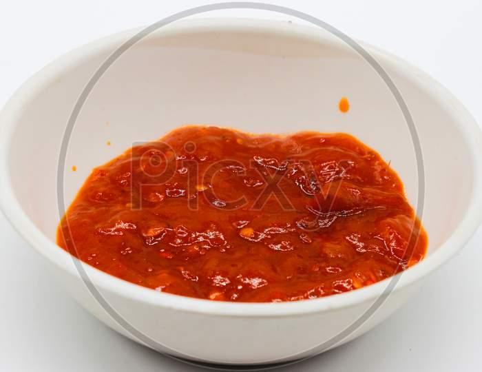 A Picture Of Tomato Sauce In Bowl