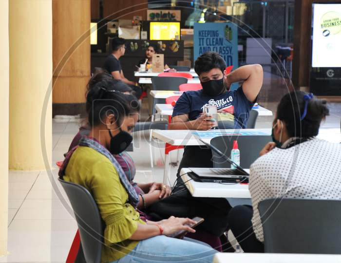 People are seen at a food court at a mall after they reopened amidst the spread of the coronavirus disease (COVID-19) in Mumbai, India on October 13, 2020.