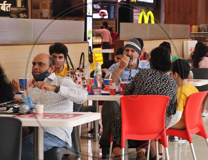 People eat at a food court at a mall after they reopened amidst the spread of the coronavirus disease (COVID-19) in Mumbai, India on October 13, 2020.