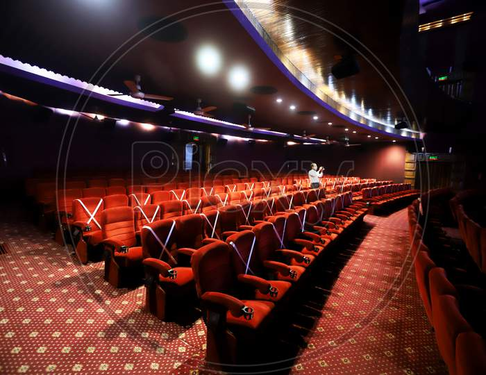 Tape is displayed on seats to implement safe distancing measures at a film theater in the  Delite cinema in New Delhi, India, on October. 13, 2020.