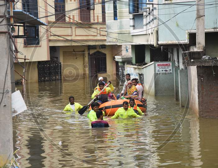 GHMC DRF teams rescue flood affected families in Al-Jubail Colony of Falaknuma in Hyderabad on October 14, 2020.