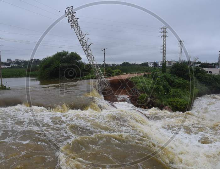 Water from Palle Cheruvu lake overflowing after its banks washed away due to the incessant rains in Hyderabad on October 14,2020.