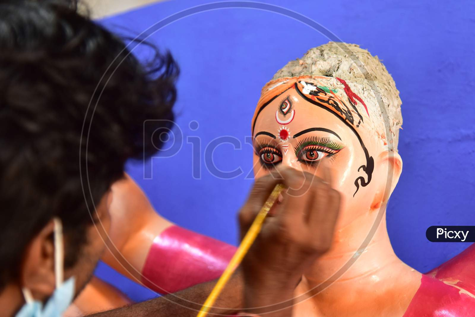 An artist gives final touches to an idol of Goddess Durga ahead of Durga Puja festival, in Guwahati, on Oct 16,2020