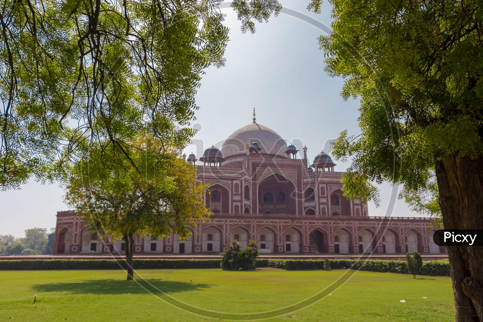 Humayun Tomb with some green tree branches