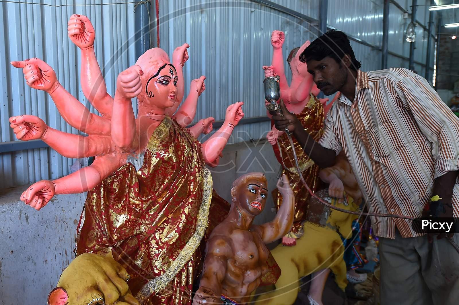 An Artisan Paints A Clay Sculpture Depicting The Goddess Durga Durga Ahead Of 'Durga Puja' Festival, In Chennai On October 15, 2020.