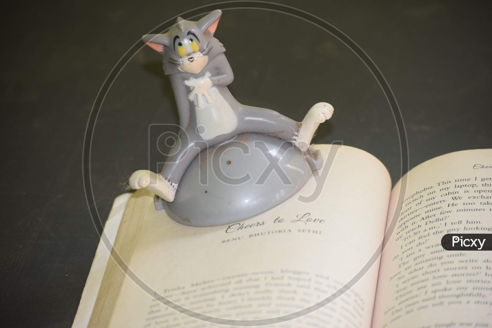Closeup Of A Book With A Toy Item Isolated On Black Background