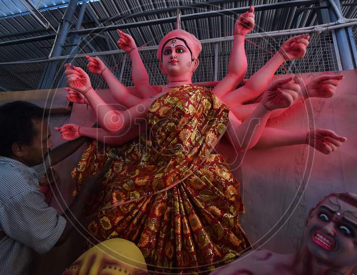 An Artisan Paints A Clay Sculpture Depicting The Goddess Durga Durga Ahead Of 'Durga Puja' Festival, In Chennai On October 15, 2020.