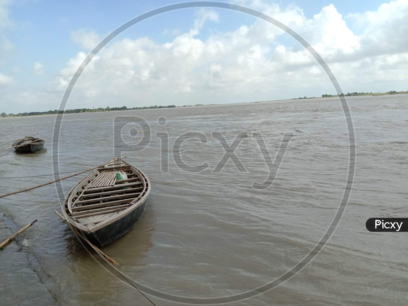 Black Colored Wooden Fishing Boat On River